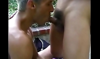 Two horny gay studs suck each other'_s dick in the garden