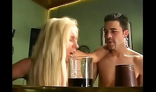 Double penetration of a blonde slut in a bar